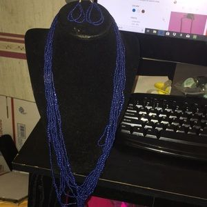 Nice long blue necklace with matching earrings